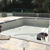 Pool Technicians Resurfacing Community Pool in Naples, Florida - Pool Equipment & Services | Stahlman Pool Company - Naples, Florida