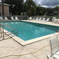 Community Pool Resurfacing Renovation - Before - Pool Equipment & Services | Stahlman Pool Company - Naples, Florida