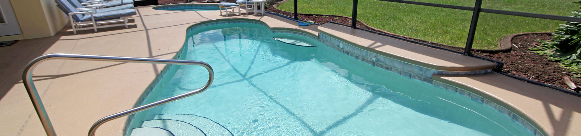 Residential Pool with seating | Stahlman Pool Company - Naples, Florida