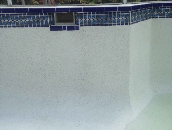 resurfacing residential pool with mosaic tiles - Pool Renovation & Repair | Stahlman Pool Company - Naples, Florida